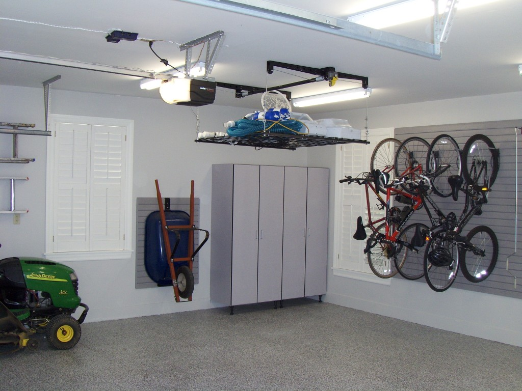 Gray tall cabinets and storewall with retractable ceiling for Garage designs com