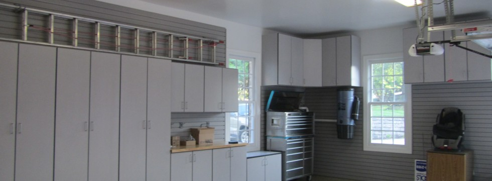 Gray garage cabinets fill an unusual space.