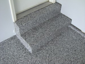 garage steps and stem walls coated in granite color