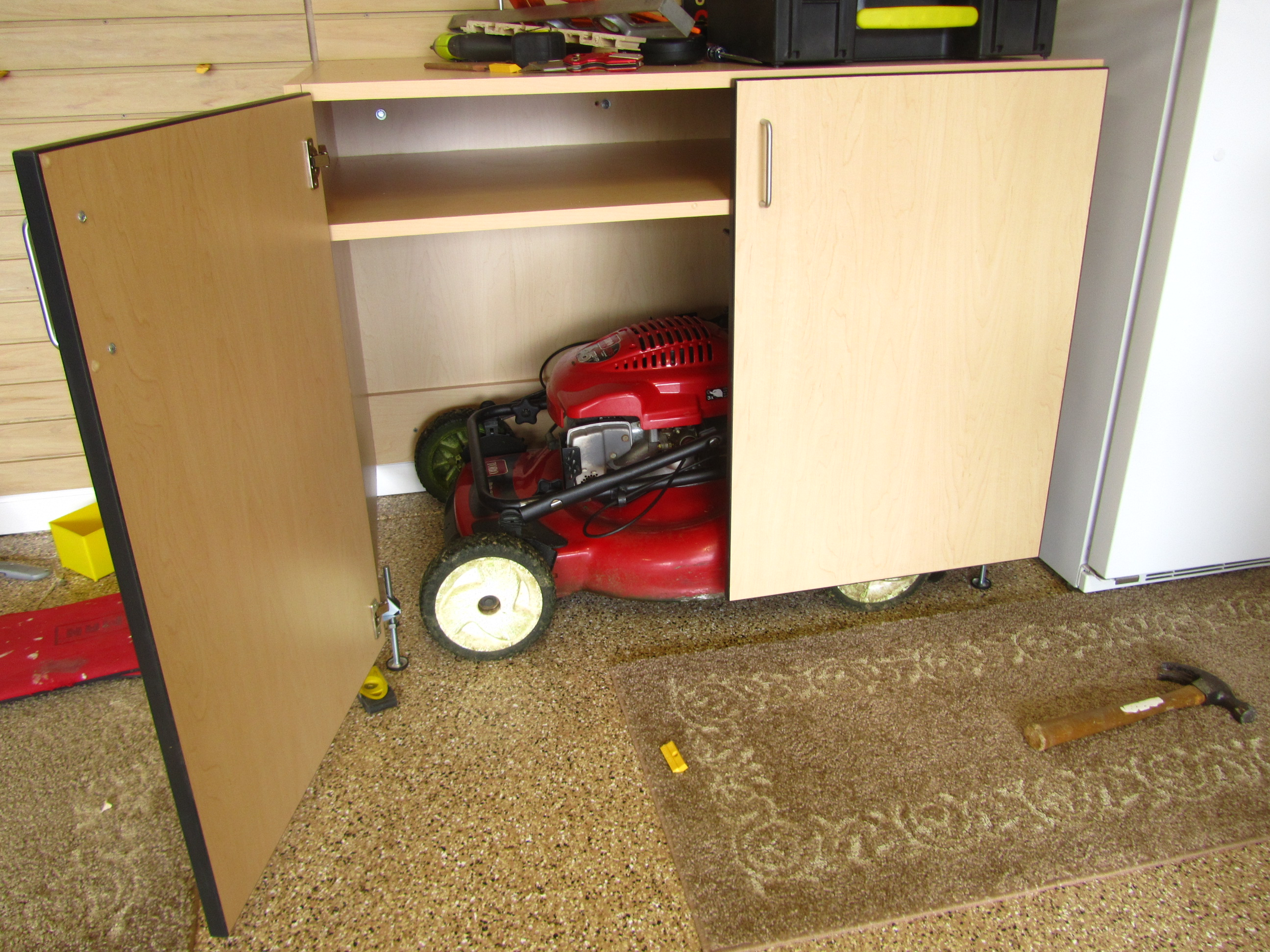 Lawnmower storage for Lawn mower storage shed