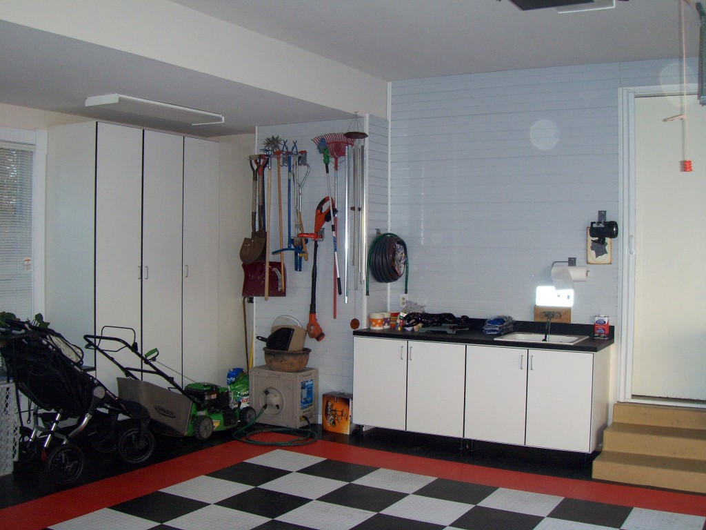 White Garage Cabinets Brighten The Space