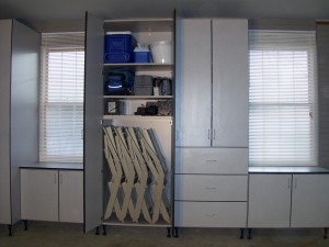 Garage cabinet holds folding chairs and coolers