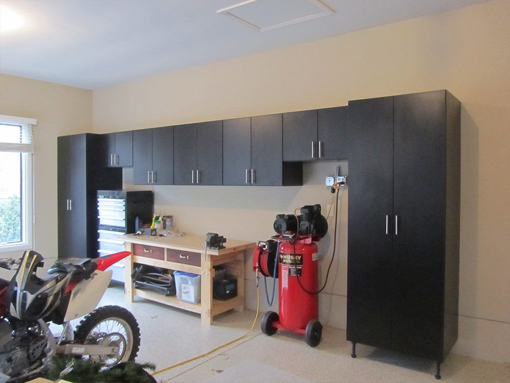 Custom garage cabinets storage solutions in st louis browse through our garage cabinets gallery solutioingenieria Gallery
