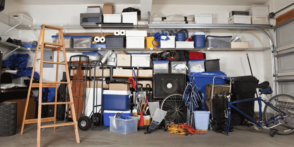 If your car space is as cluttered as this you need to organize your garage. We can help!